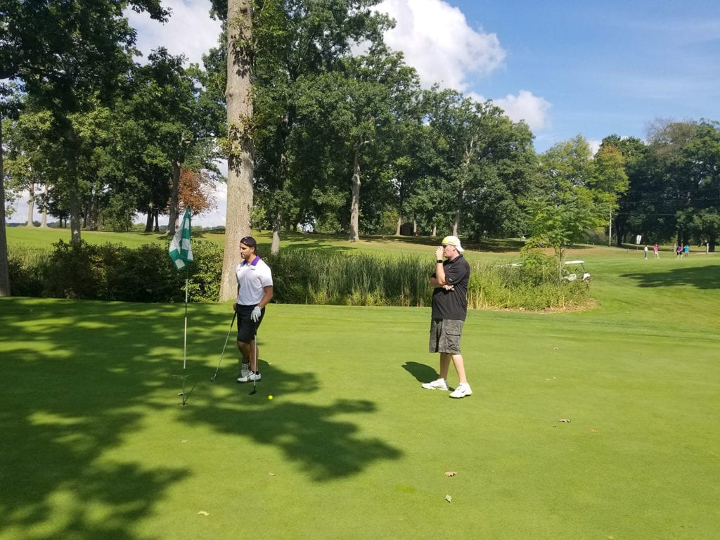 Brian-and-Alex-sizing-the-putt-up