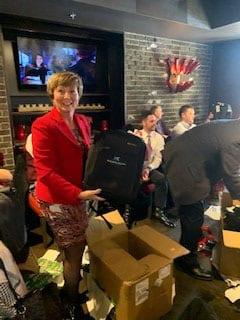 Partners-surprise-staff-w-HK-backpacks-1